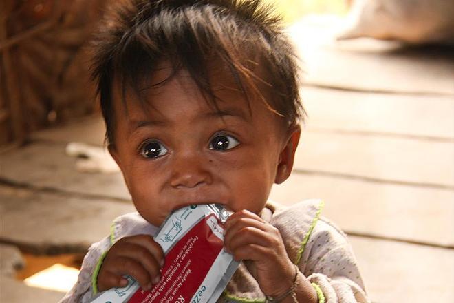 Child consuming eeZeePaste™ NUT